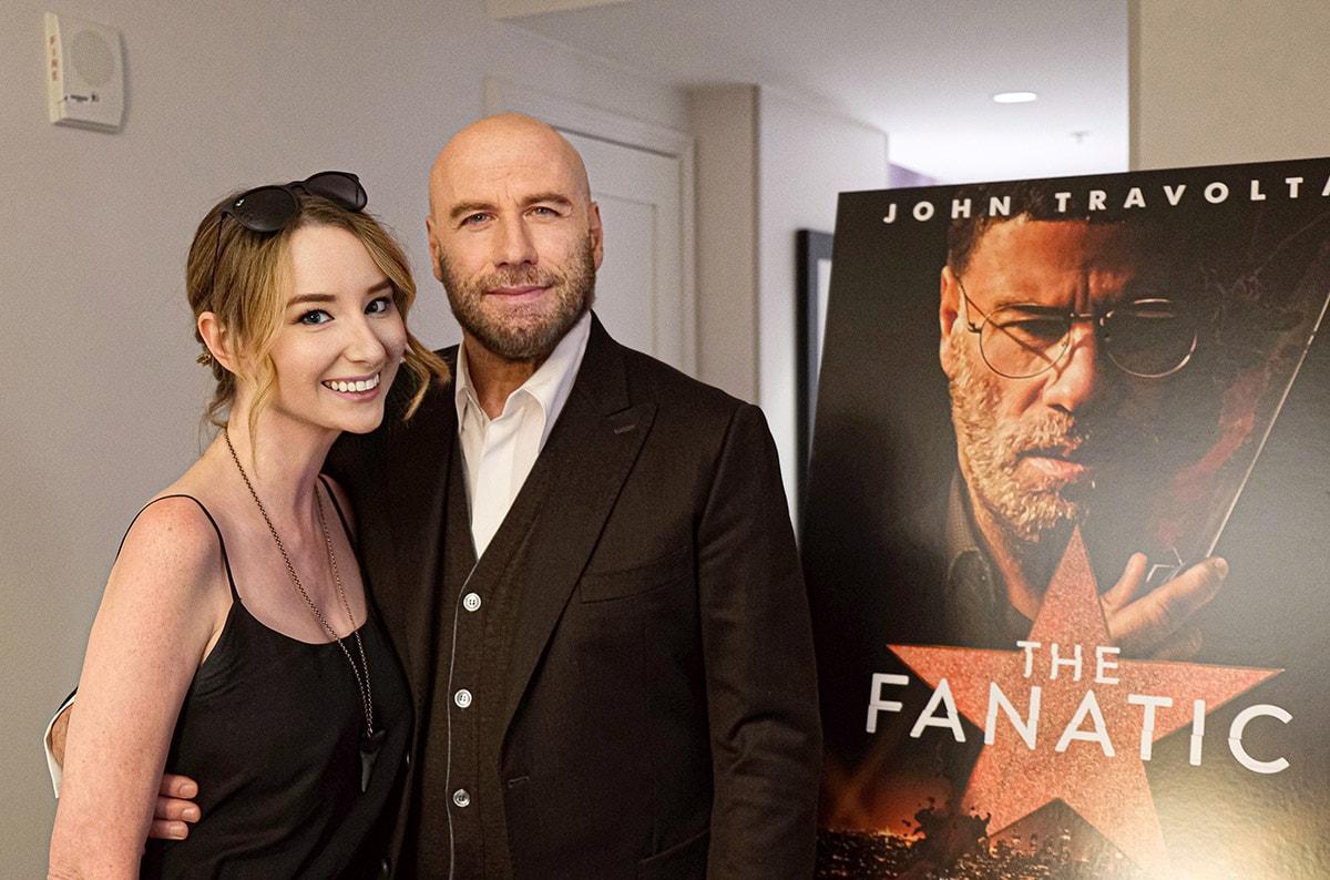 John Travolta and FanBolt's Emma Loggins